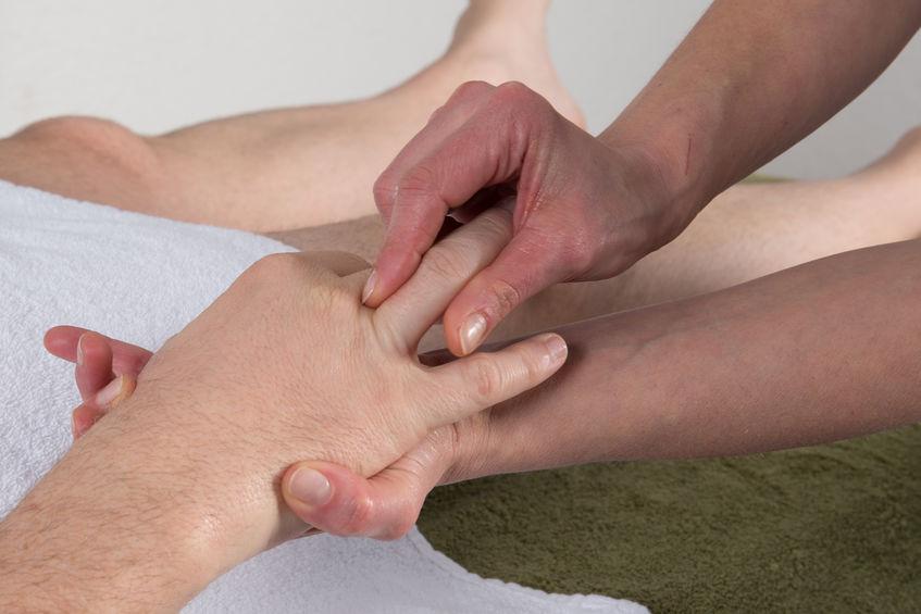 Woman doing a hand massage to a man